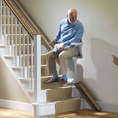 man riding chair lift up stairs - Lift Up Stairs